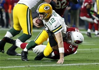 Aaron Rodgers , Dwight Freeney
