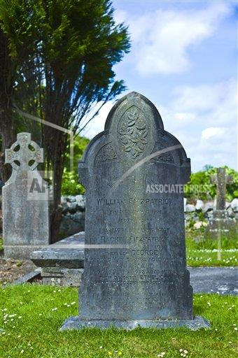 Creative Robert Harding Productions /AP Images A  County Clare Ireland 1161-6691 Gravestone of William Fitzpatrick and his family in churchyard at Corofin, County Clare, West of Ireland