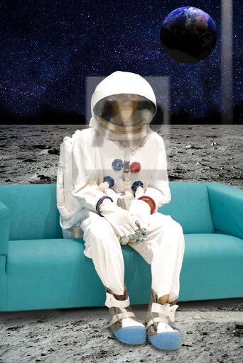 Man on the moon sitting on couch