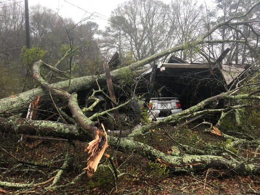 Downed Trees Rest On A Shed And Vehicle Belonging To Mike Herington Damaged Near Baxley Ga Early Sunday Jan 22 2017 The National Weather Service Said