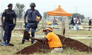 South Africa Bodies Exhumed