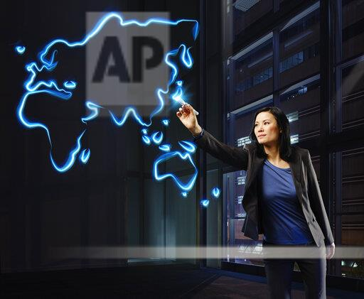 Businesswoman painting a worldmap with light, pointing on Japan