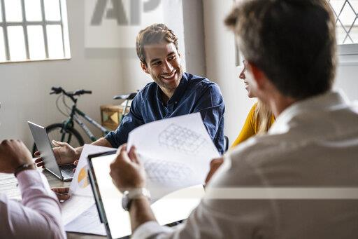 Confident business team having a meeting in loft office