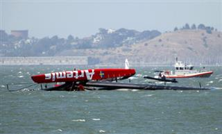 APTOPIX Americas Cup Capsized Boat