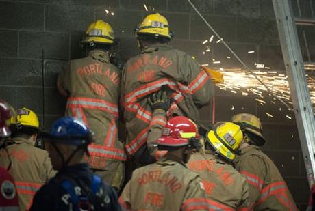Firefighters rescue woman trapped in a wall