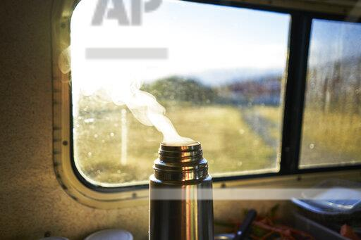 Steaming thermos flask in camper