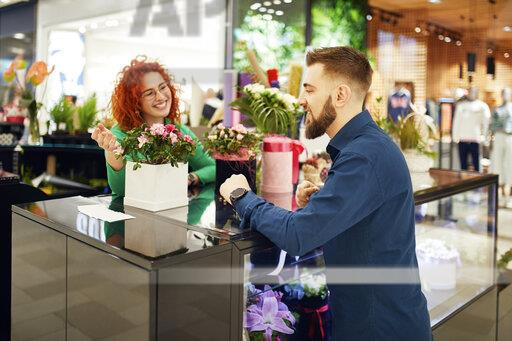 Florist talking to customer in flower shop