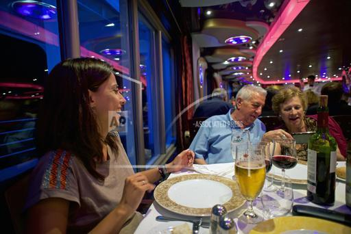 Family enjoying dinner in cruise ship