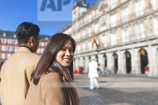 Spain, Madrid, happy young tourist couple on Plaza Mayor