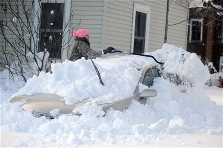 Abbie J. Haie digs out her grandmother's car at their home on Tuesday, Nov. 18, 2014 in Edwards, N.Y.