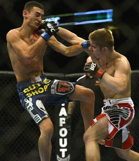 Justin Lawrence, Max Holloway