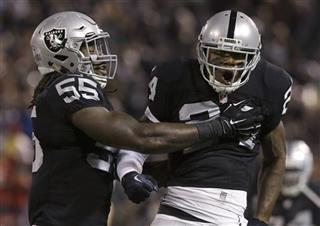 Charles Woodson, Sio Moore