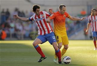 Andres Iniesta, Tiago Mendes