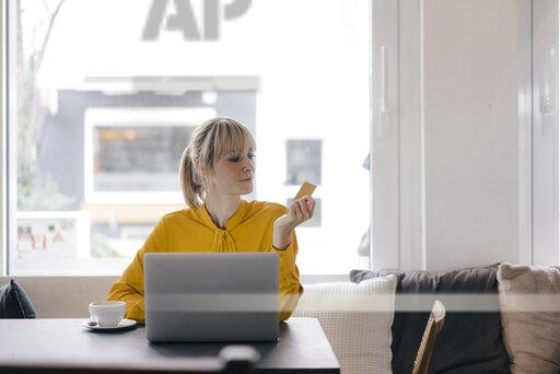 Blond woman doing online payment with her credit card