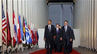 Barack Obama, Anders Fogh Rasmussen, David Cameron.