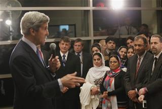 U.S. Secretary of State Kerry talks to staff during his visit to the U.S. Embassy in Kabul