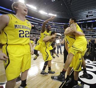 APTOPIX NCAA Michigan Florida Basketball