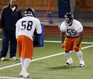 Lance Briggs, D.J. Williams