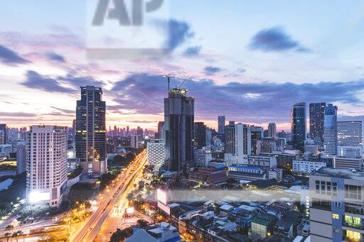 Thailand, Bangkok, aerial view of highway and skyscrapers in the city at sunrise