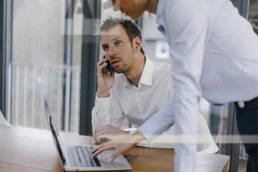 Business people working in office, man talking on the phone
