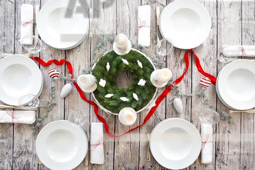 Laid table with Advent wreath and Christmas decoration