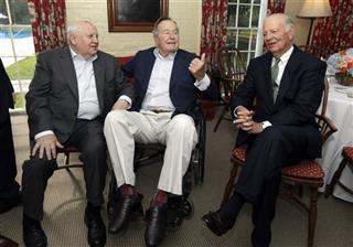 Mikhail Gorbachev, George H.W. Bush, James Baker