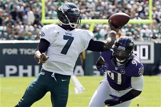 Michael Vick,  Courtney Upshaw
