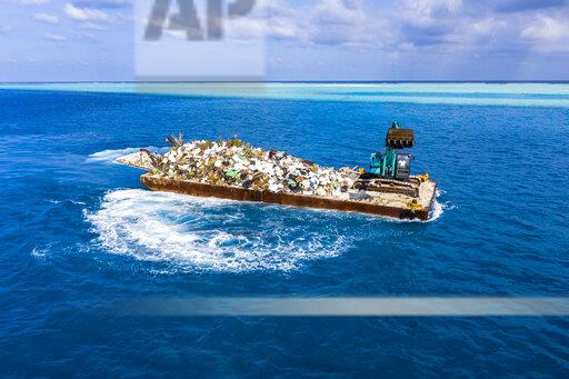 Maledives, South-Male-Atoll, plastic waste disposal with digger