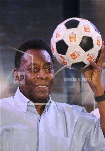 Brazilian football legend Pele poses with a football during an interaction session with the students of NSHM Knowledge Campus in Kolkata, India, Monday, Oct. 12, 2015. Pele is in Kolkata during a three-day visit and will also fly to the national capital New Delhi to attend the Subroto Cup 2015 football final match, according to local reports.