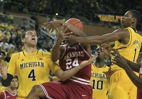 Mitch McGary, Michael Qualls, Glenn Robinson III