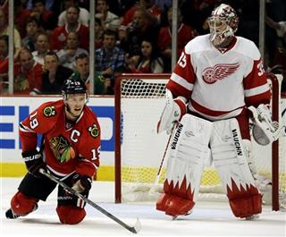 Jonathan Toews,  Jimmy Howard