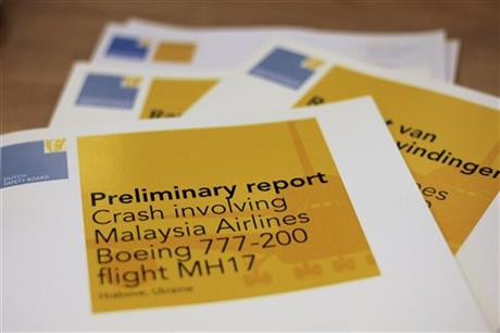 A stack of preliminary reports by the Dutch Safety Board on the crash of Malaysia Airlines flight MH17 is displayed at the board's headquarters in The Hague, Netherlands, Tuesday, Sept. 9, 2014. (AP Photo/Mike Corder)