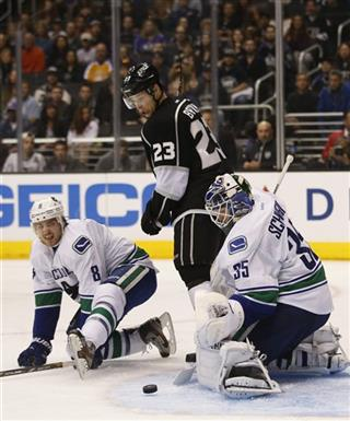 Dustin Brown, Cory Schneider, Chris Tanev