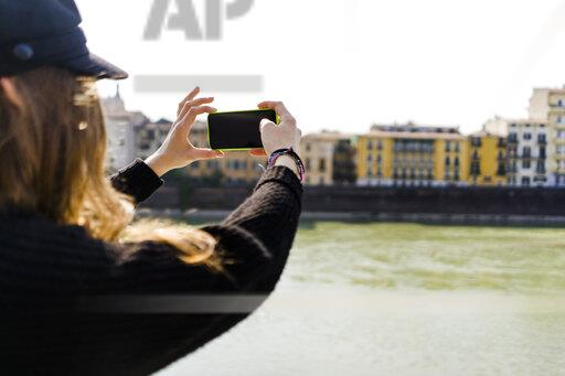 Young woman in Verona using smartphone