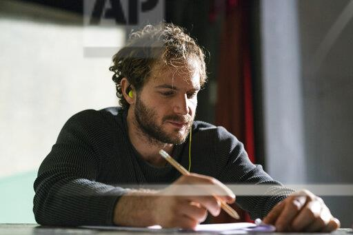 Portrait of man at theatre working on script