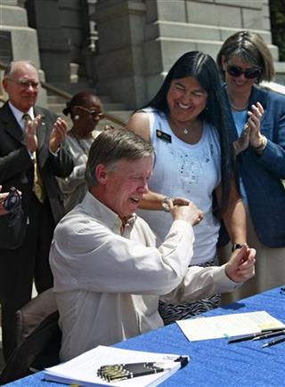 John Hickenlooper, Irene Aguilar