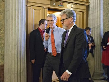 Tom Coburn, Rob Portman