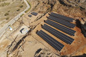 In this Thursday , Aug. 9, 2018, photo, a solar park on the Aegean island of Tilos, Greece. Tilos with its winter population of 400 and summer population of some 3000, will become the first island in the Mediterranean to run exclusively on wind and solar power, when the blades of the 800 kilowatt wind turbine start turning. (AP Photo/ Iliana Mier)