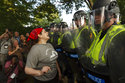 Emily Filler attempts to dissuade state police from advancing on students rallying on the grounds of the University of Virginia on the anniversary of the