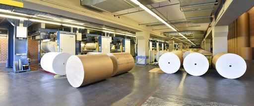 Printing shop: paper roll at printing presses
