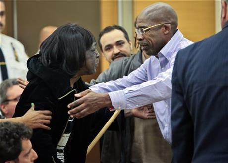 Jonathan Fleming, left, reaches to hug his mother Tricia Fleming