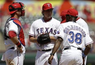 Ron Washington, Derek Holland, A.J. Pierzynski
