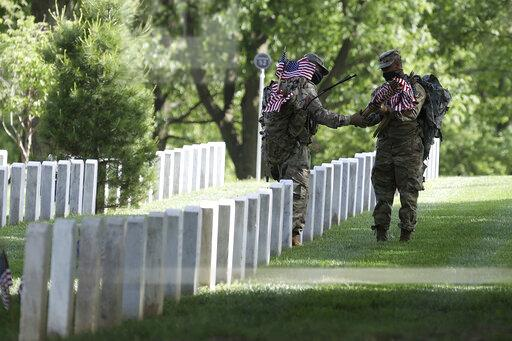 US Soldiers Place Flags at Arlington Cemetery For Memorial Day