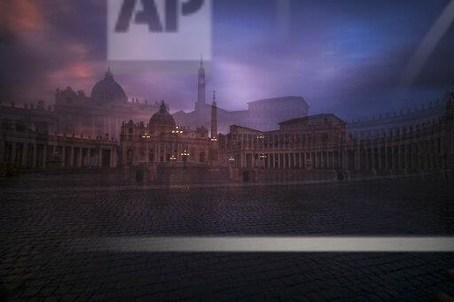 Italy, Rome, View of St. Peter's Basilica and St. peter's square at Vatican fog in the evening