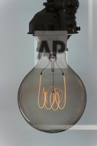 Light bulb with glowing filament