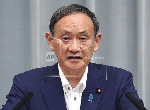 Japan's Chief Cabinet Secretary attends press conference