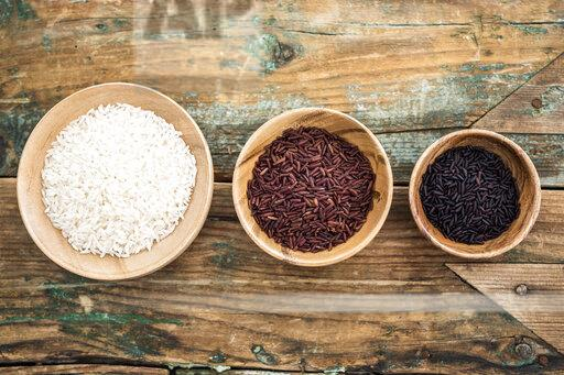 RIce, red rice, black rice in bowls, from above