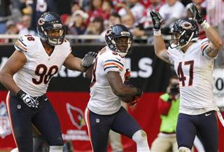 Zack Bowman, Corey Wootton, Chris Conte