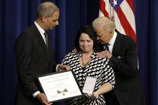Joe Biden, Eric Holder, Angela Miller