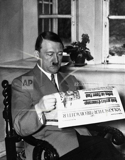 Creative Copyright Corbis/AP Images A    NA006653 Hitler Reading Newspaper